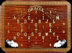 """MYSTIFYING ORACLE William Fuld Design on metal 1930's Could this be the """"Holy Grail"""" of Ouija boards? If it isn't the rarest of all William Fuld boards then it certainly is ahead of whatever is in second place. Read more about this odd metal Mystifying Oracle with the weird battery operated light-up planchette on our Electric Mystifying Oracle page."""