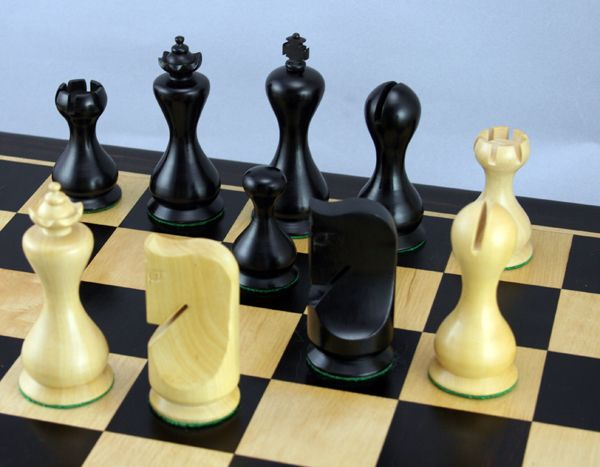the chess pieces are distinctively shaped and appeal to many chess