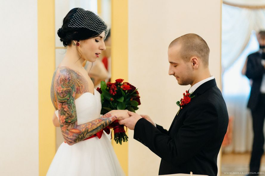Exchanging Of Rings Tattooed Bride And Groom