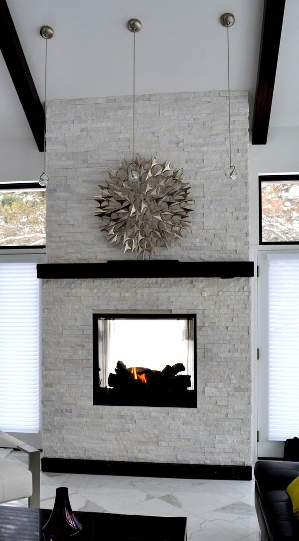 White Stacked Stone Fireplace