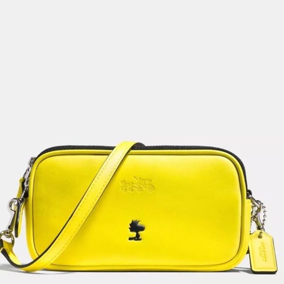 0420ae4416 NWT Coach X Snoopy Woodstock Crossbody bag! This is the Coach Peanuts  collection cross body bag in yellow. Sold out in stores and a limited  edition ...