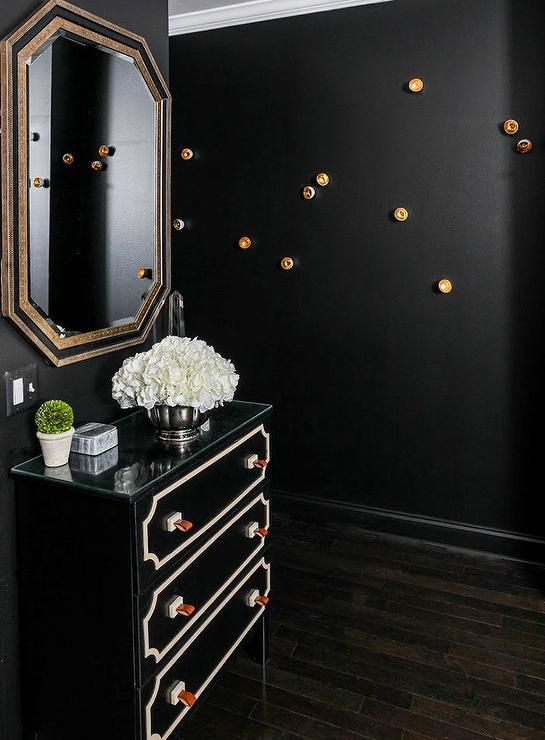 contemporary foyer features walls painted black sherwin williams tricorn black lined with a. Black Bedroom Furniture Sets. Home Design Ideas