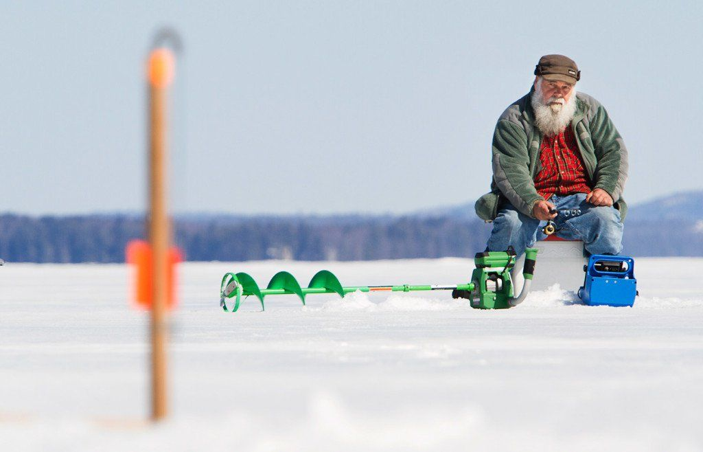 Icefisherman Ervin Lizotte of Lebanon keeps an eye on a trap as he jigs for rogue. Though open water fishing is an option all year in Maine, April 1 is the date many fisherman mark on their calendars as the fish day to hit the state's lakes and ponds.
