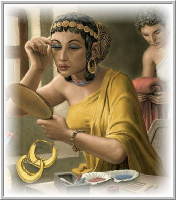 Ancient Mesopotamian woman applying khol to her eyes.