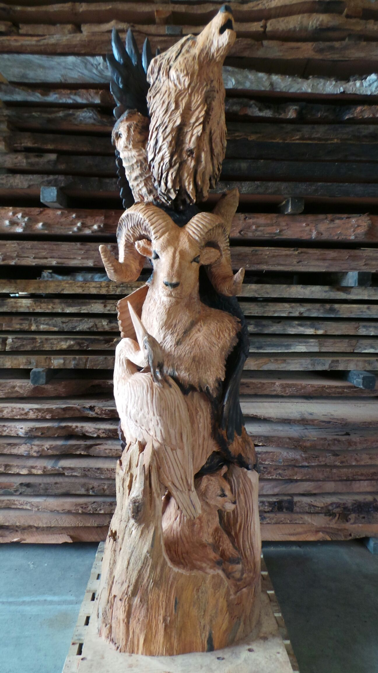 Custom carved totem pole we do carvings call us