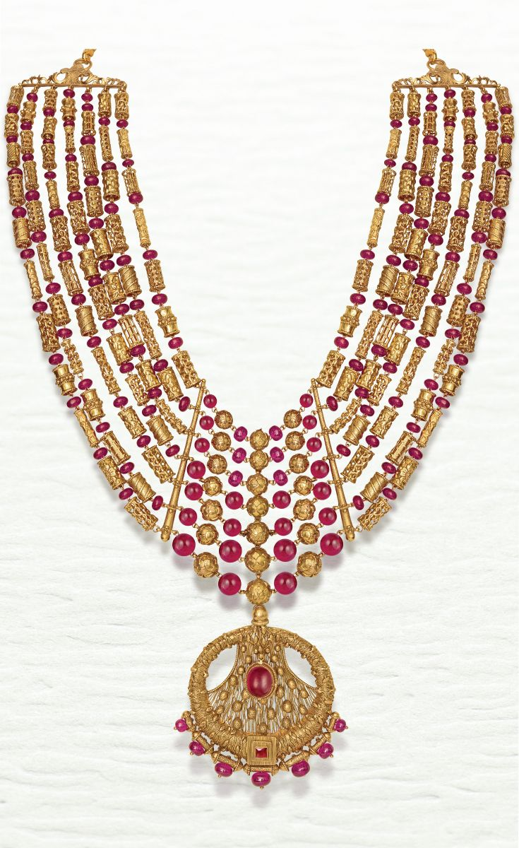 Modern gold haar with contrasting pink beads by azva goldjewellery