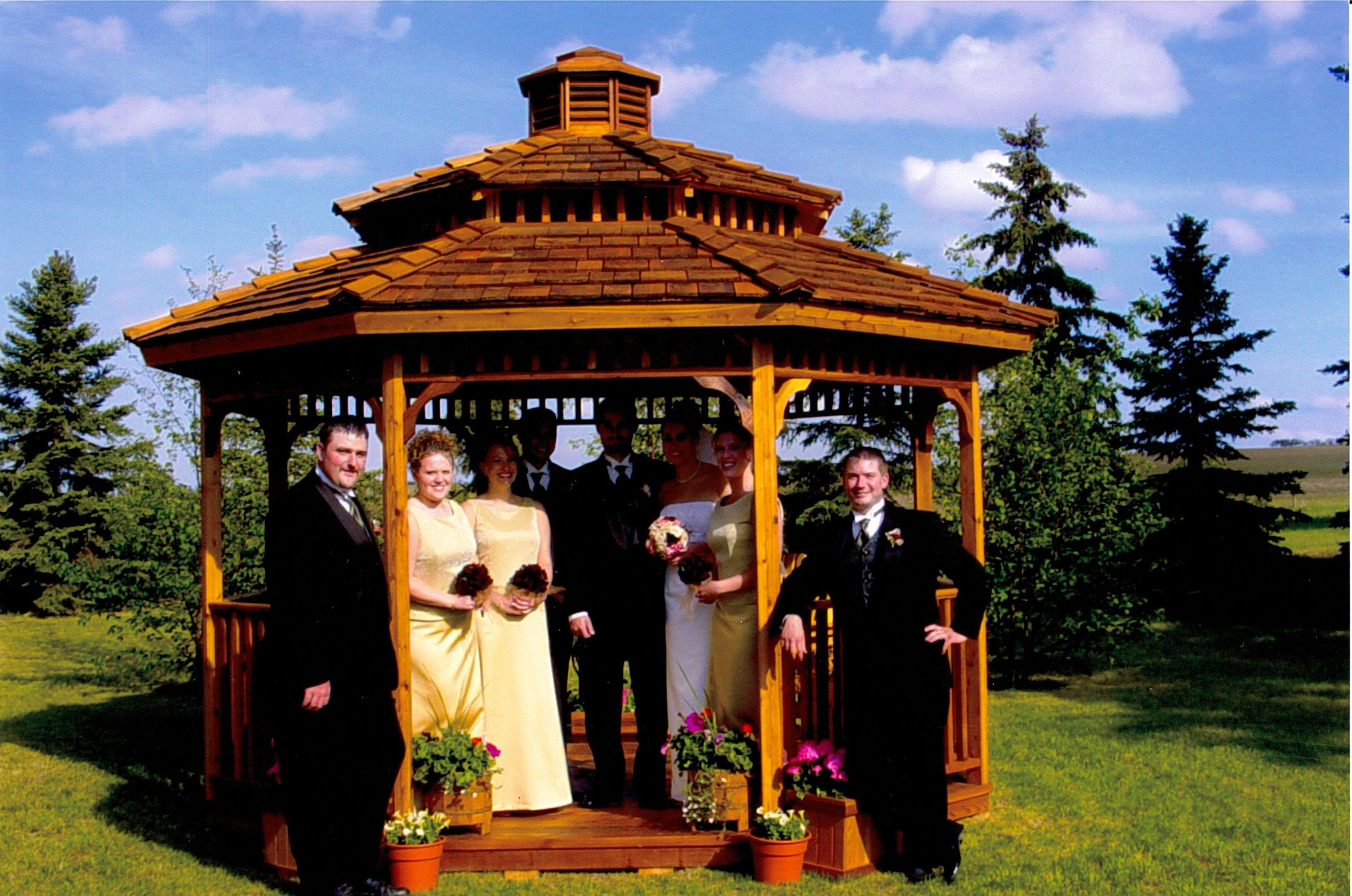 Octagon wedding gazebo kit features two tier roof with ornamental cupola and comes in 12' and 14' sizes.  visit: cedarshed.com