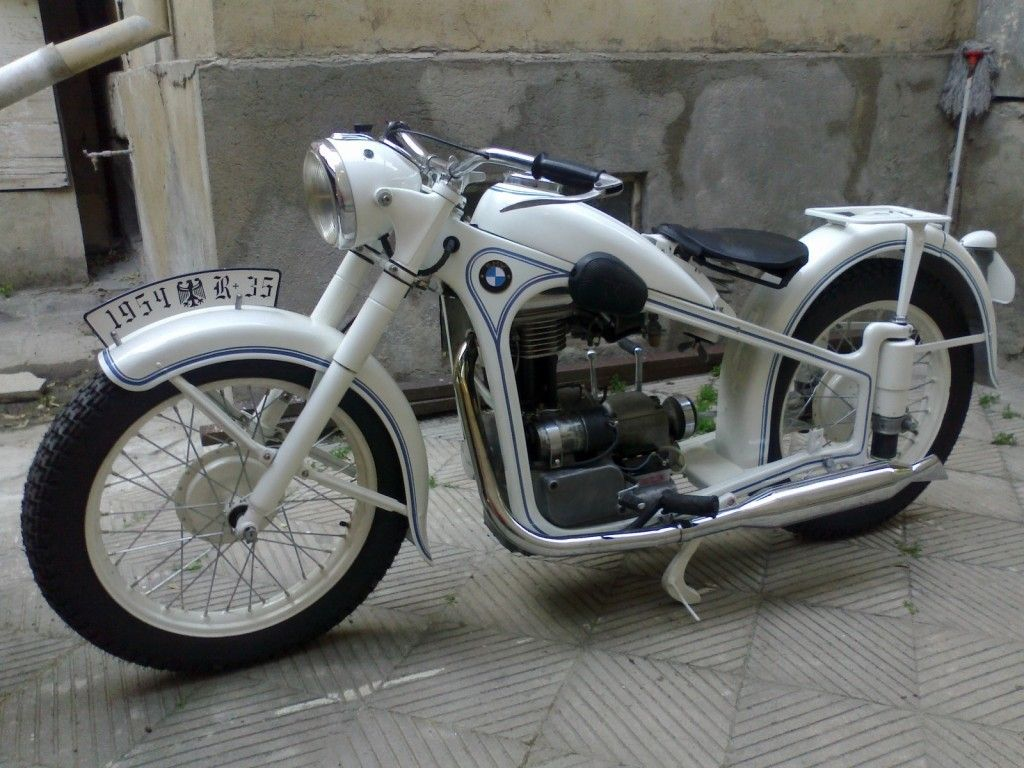 a restored bmw r35 - 1954 motorcycle featuring photographs and