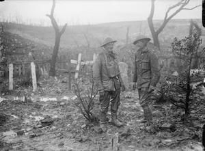WWI, Nov 1916, Somme; The soldier on the left has been extricated from the mud into which he had sunk up to the arm pits. Beaumont Hamel. ©IWM
