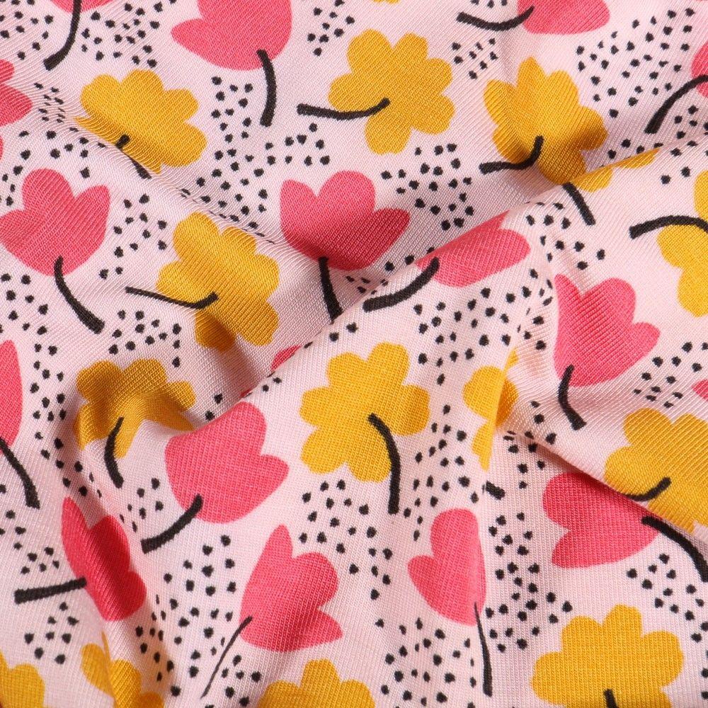Tissu Jersey Modal Trèfles roses et jaunes sur fond Blanc - Par 10 cm
