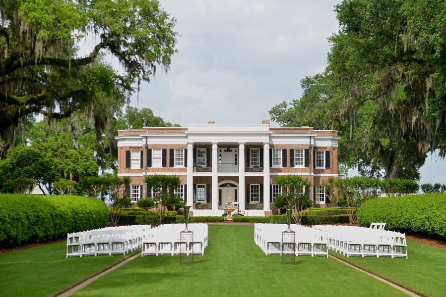 SAVANNAH WEDDINGS – Tori + David's Ford Plantation wedding planned by Anne Bone Events with an orange and yellow color palette, Anne Barge dress from Kleinfeld's, Flowers by Kiwi Fleur, Photographed by Donna Von Bruening