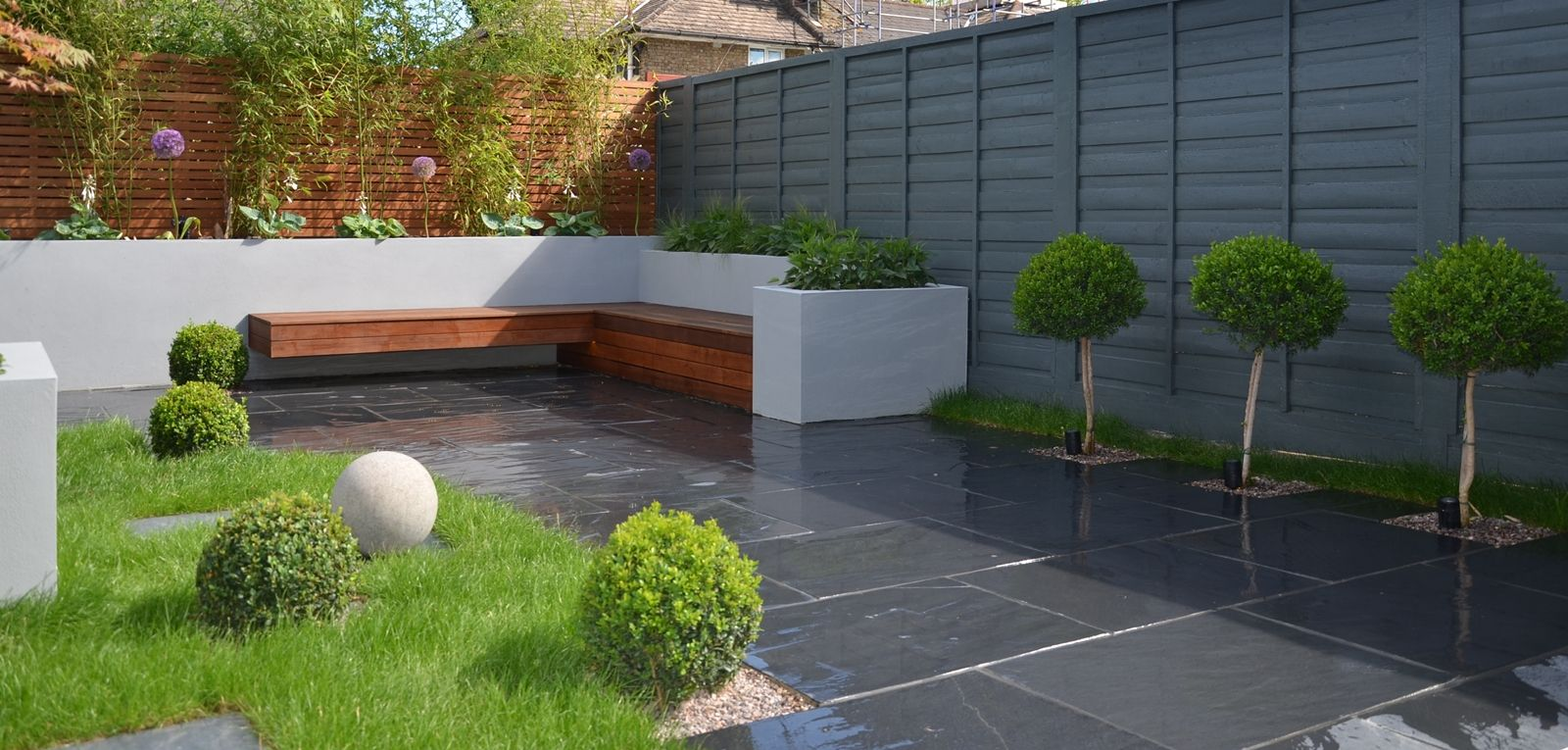 Ultra low maintenace garden with slate paving and hardwood for Garden paving designs