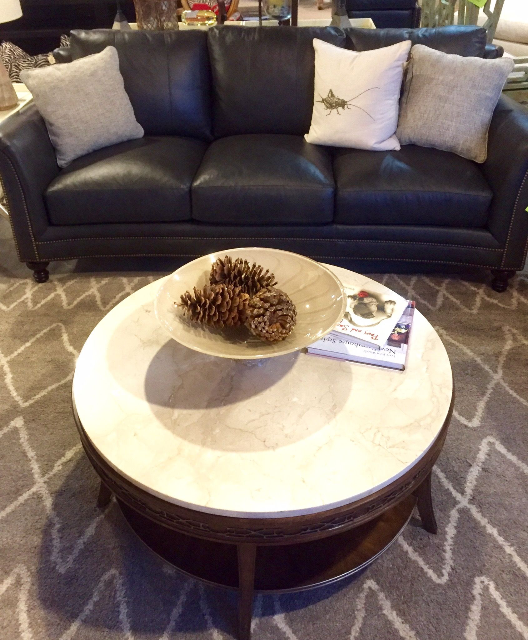 Black Leather Couch Paired With A Marble Top Coffee Table This