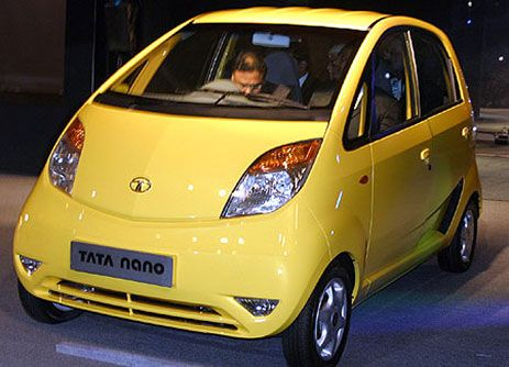 """Jan 10, 2008:  World's cheapest car debuts in India.  New Delhi Auto Expo in India, Tata Motors debuts the Nano, billing it as the world's cheapest car: The anticipated price tag is around $2,500. Tata, India's largest automaker, called the four-door, bubble-shaped mini-vehicle (it was just 5 feet wide and 10 feet long) the """"People's Car"""" and declared that it would be a vehicle for families who previously hadn't been able to afford a car."""