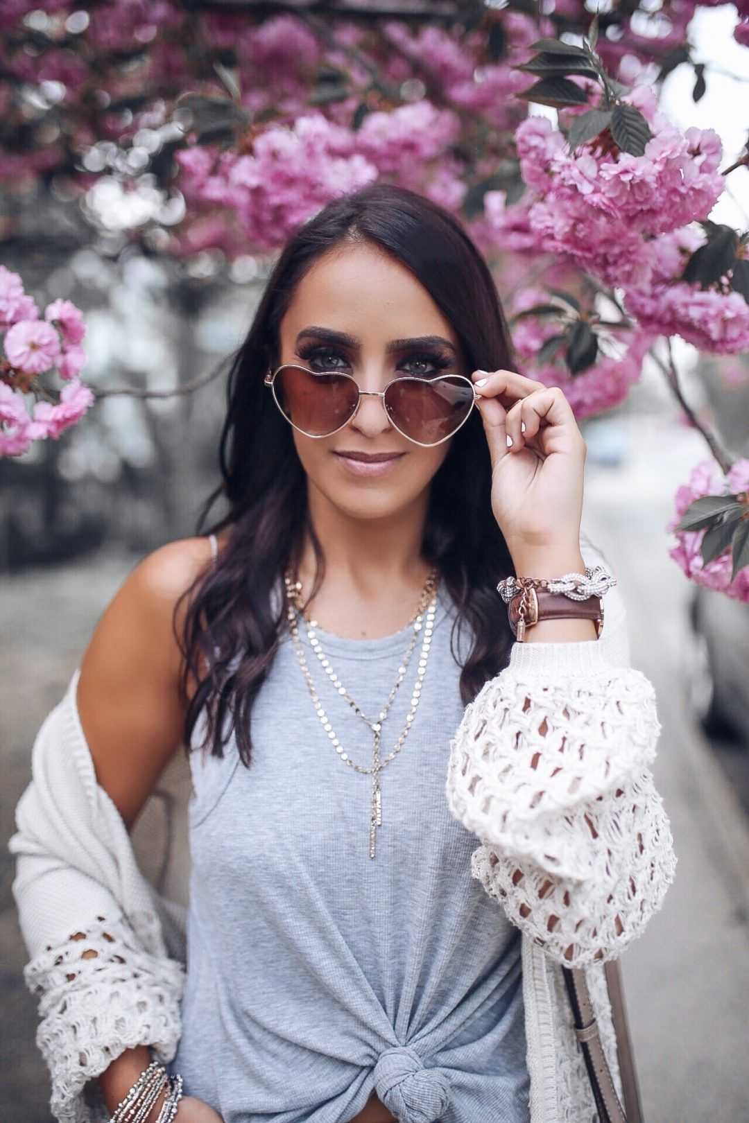 e5b9f51fb23b Blogger Sarah Lindner of The House of Sequins wearing Free people gray tank  top. Marc Fisher wedges. Baublebar layered necklace. Heart sunglasses.