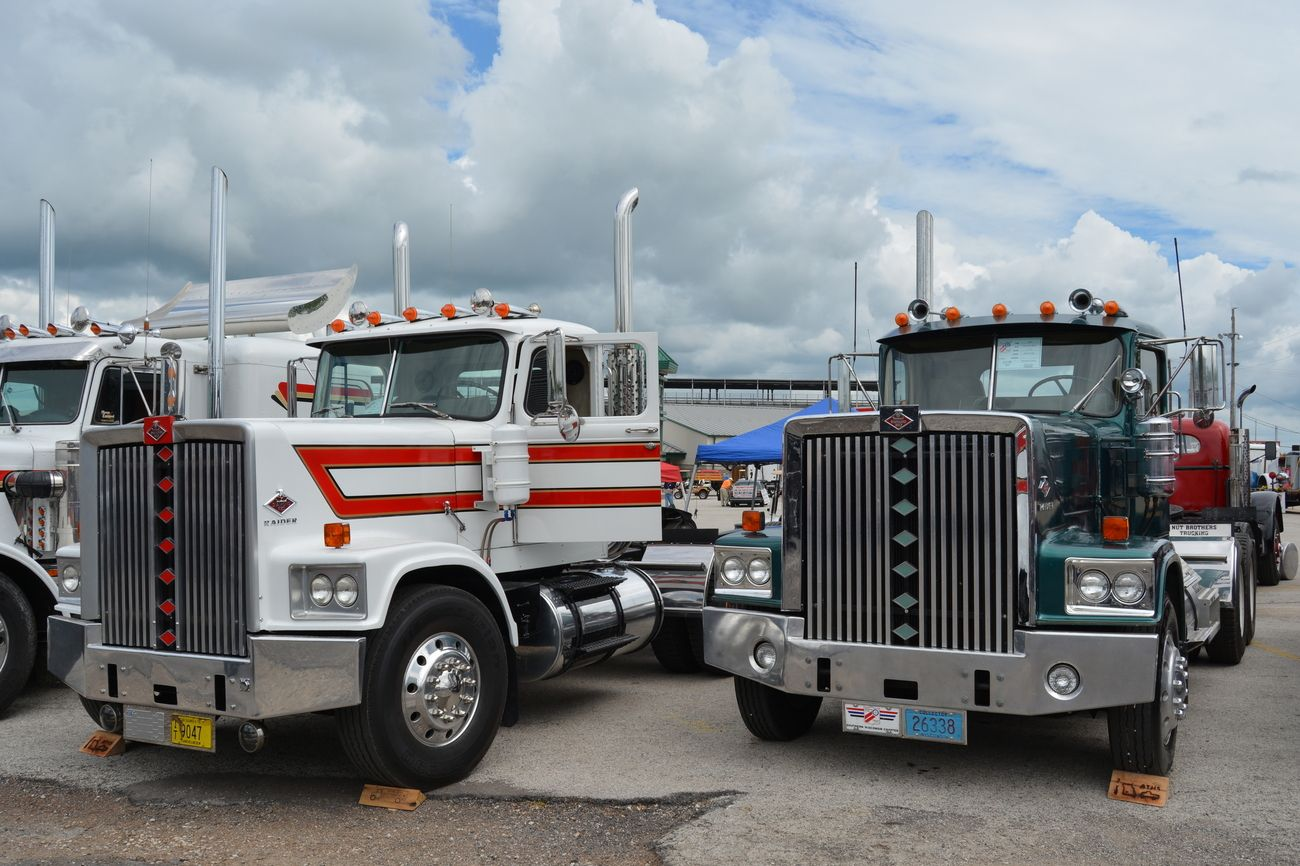 A pair of diamond reo raiders at the aths antique truck show springfield mo