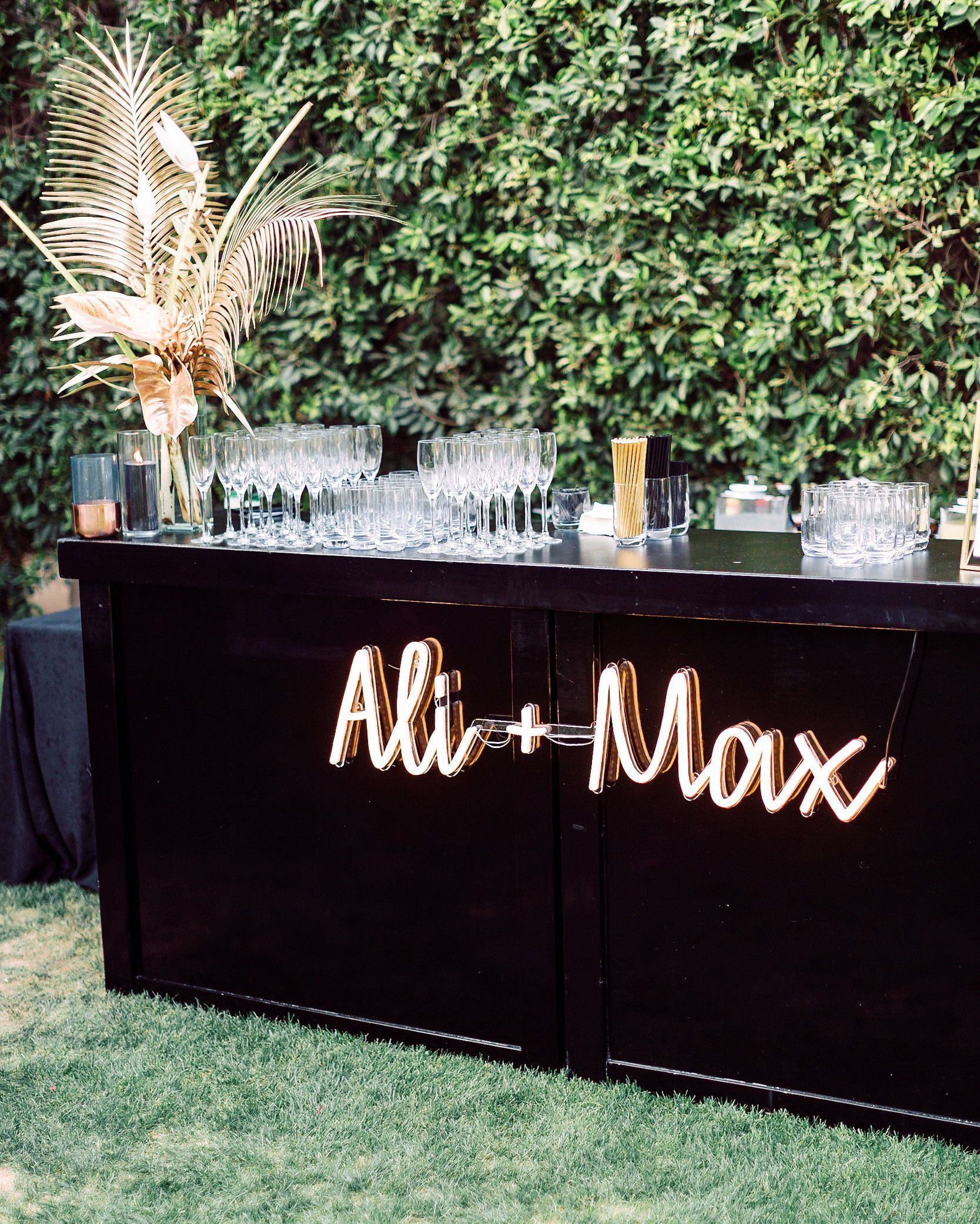 Customize your cocktail hour by hanging a neon sign (this one is by Echo Neon) that features your names on the front of your wedding bar. #Wedding #WeddingSigns #NeonSign #WeddingIdeas #Unique #Modern #WeddingTrends | Martha Stewart Weddings - 20 Ways to Use Neon Signs to Light Up Your Wedding #dream wedding 20 Ways to Use Neon Signs to Light Up Your Wedding