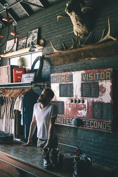 rustic shop interior . brick wall . black . log cabin style . fashion . clothing . store