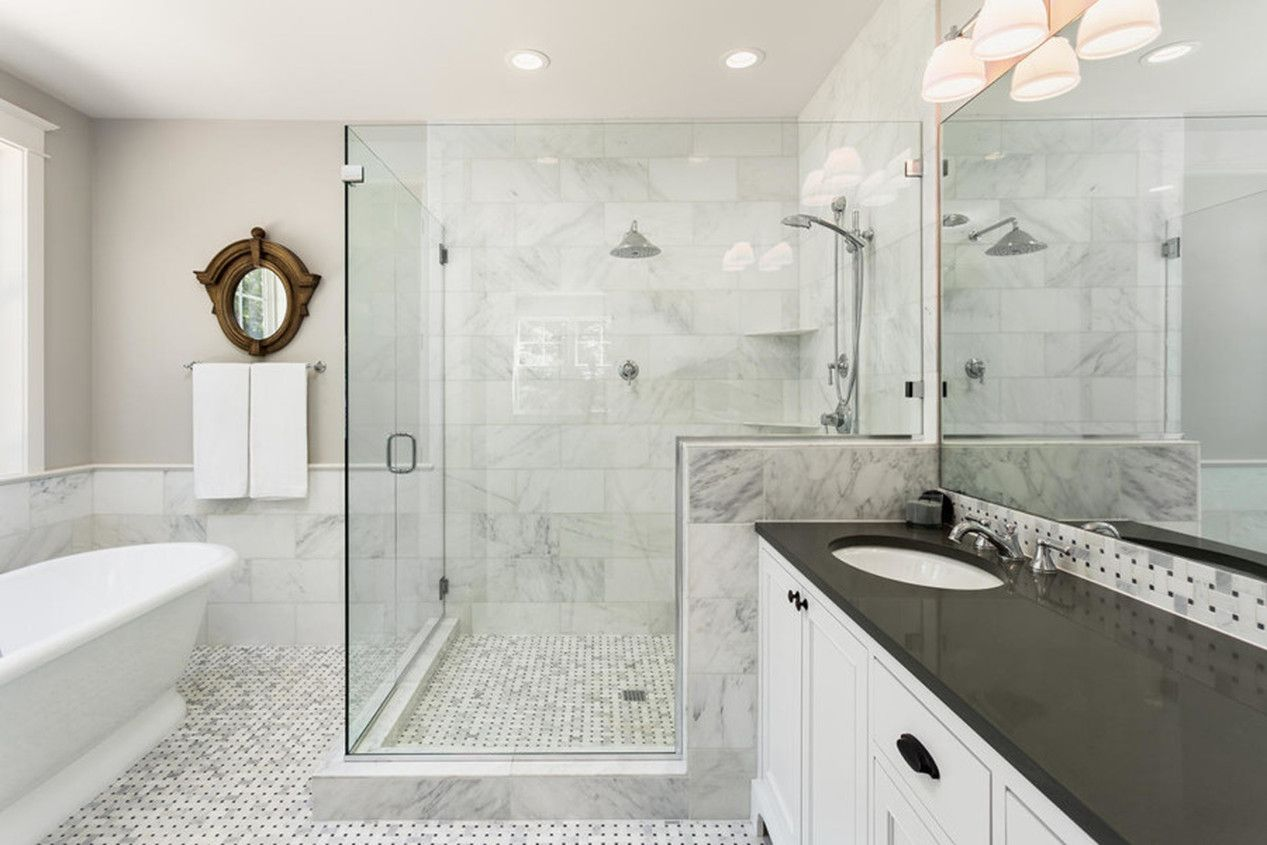 Modern Calgary Bathroom With Glass Pane Shower And Marble Countertops Great Bathroom Renovation Inspo Bathroom Remodel Cost Bathroom Trends Bathrooms Remodel