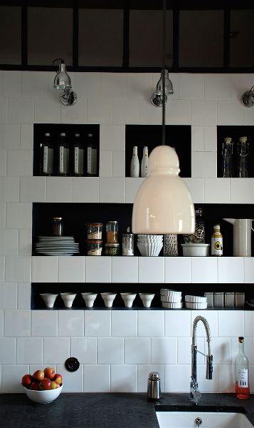 white tile backsplash + recessed storage + lighting in kitchen by