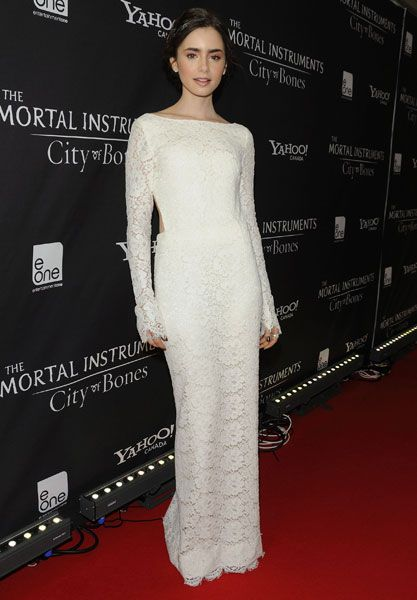 Lily Collins rocked the red carpet in Toronto for The Mortal Instruments premiere.