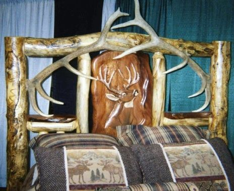 Youth log bed with buck and doe hand carved headboard