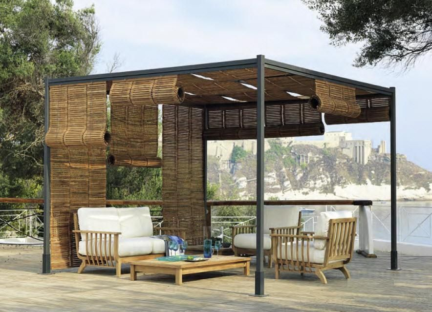 a small defined outdoor room with roll-up bamboo screens for privacy ...