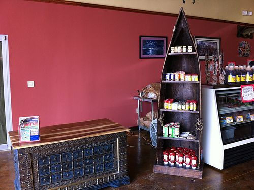 B & J Seafood in Hammond, LA filled up their warehouse store with furniture from Discoveries. Here is a desk and a bookshelf made from an old boat from India.