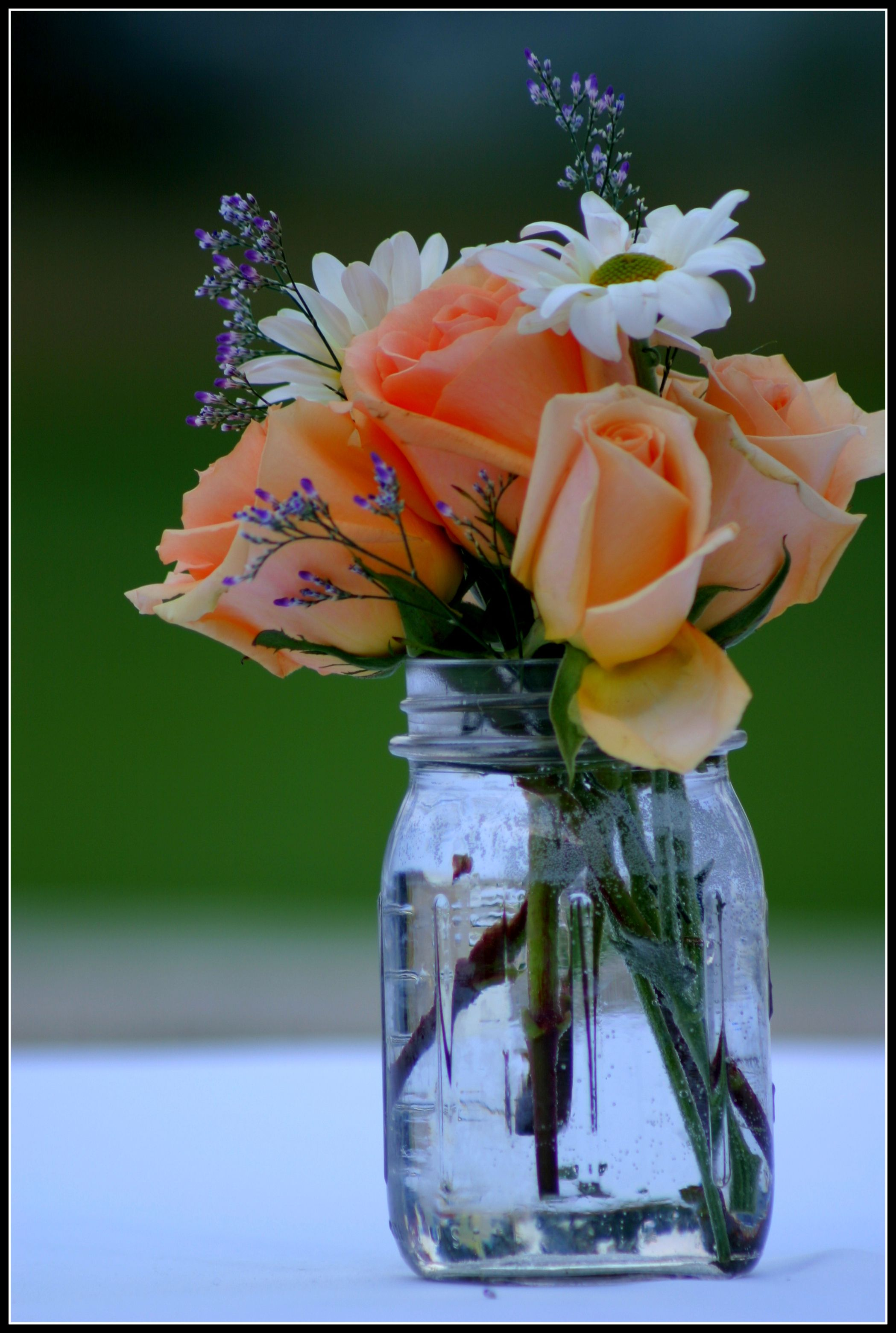 Roses mason jar flower arrangement centerpiece