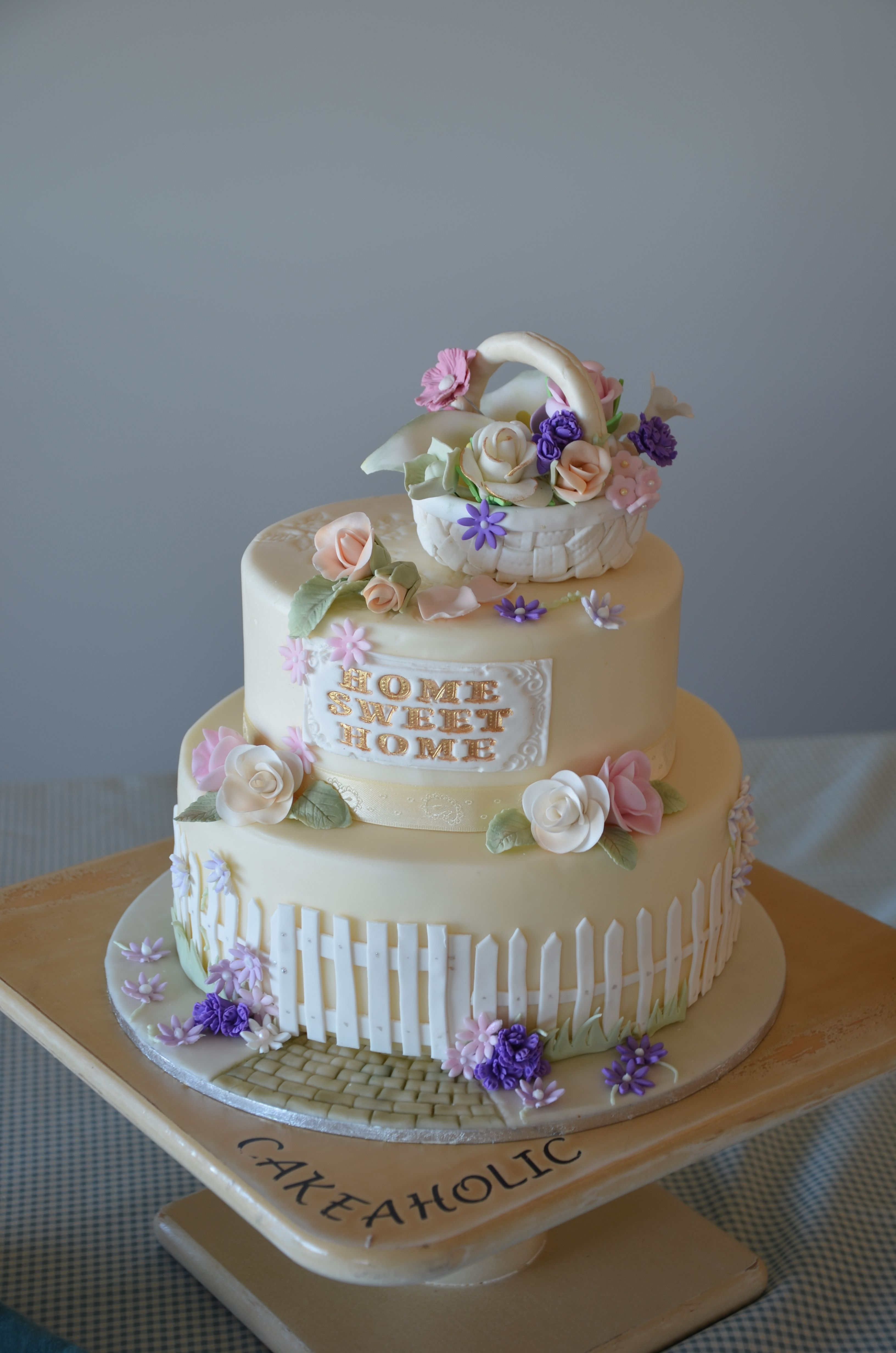My present cake - This is a photo of a cake I did with all the left over flowers I made.