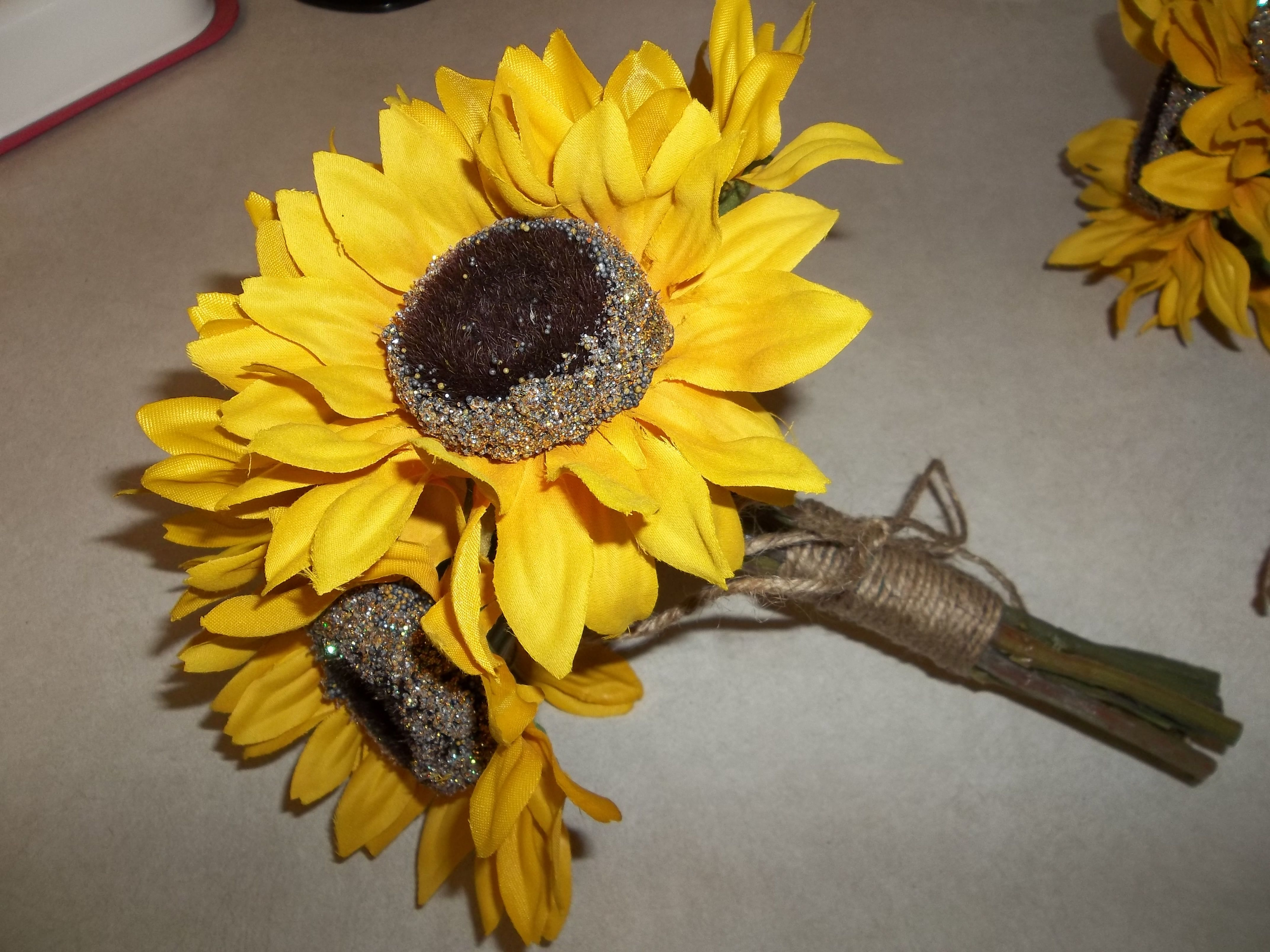 Wedding bouquets of sunflowers  Not the flowersbut love the simple twine tie  Flowers for