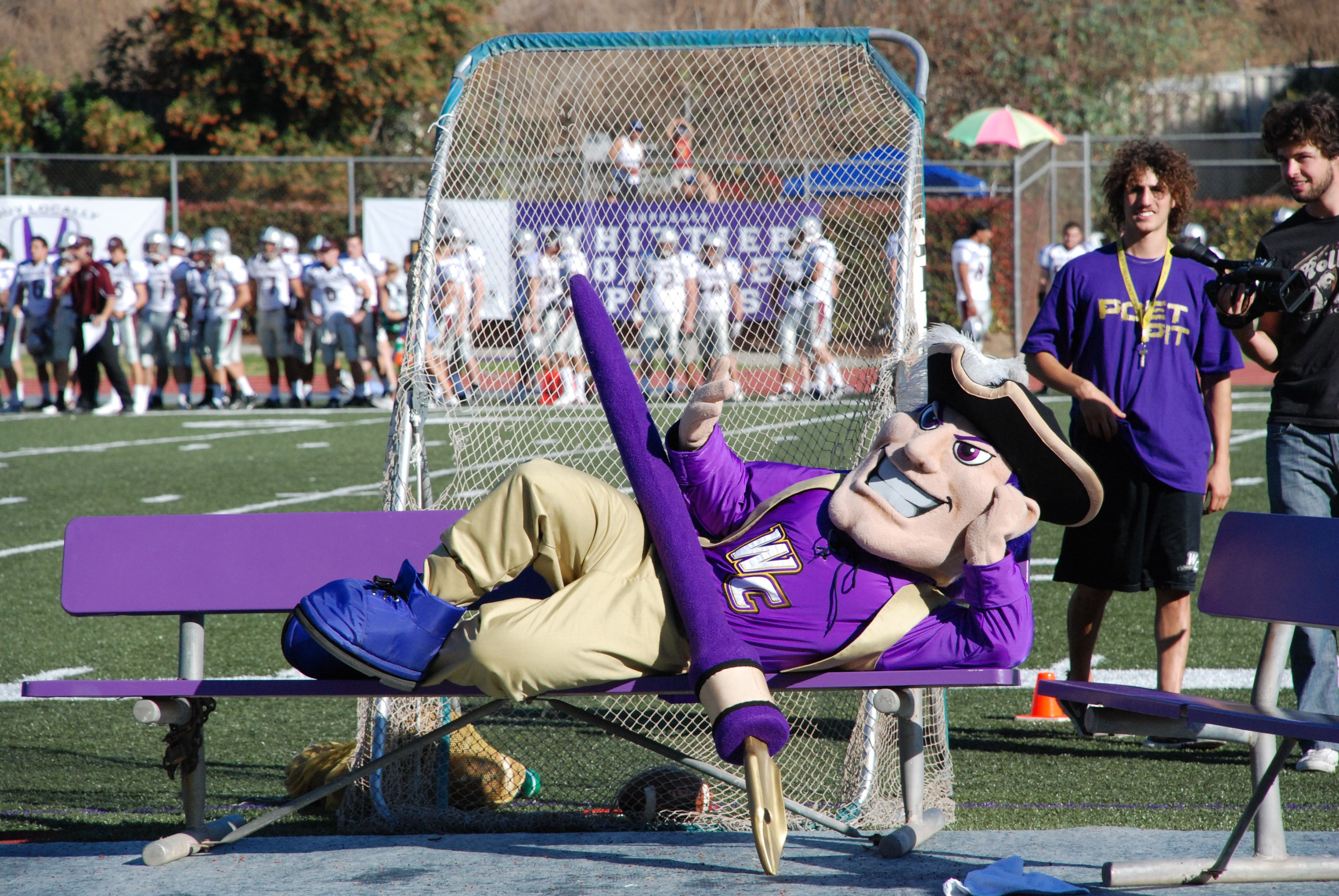 Johnny poet getting the crowd ready at a football game