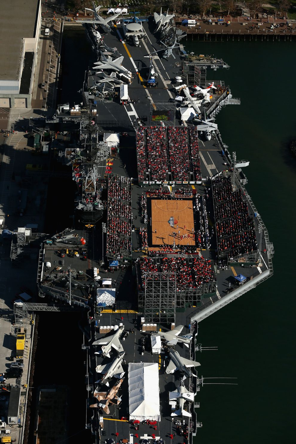 21 Breathtaking Photos Of A College Basketball Game Played On An Aircraft Carrier College Basketball Game Aircraft Carrier College Basketball