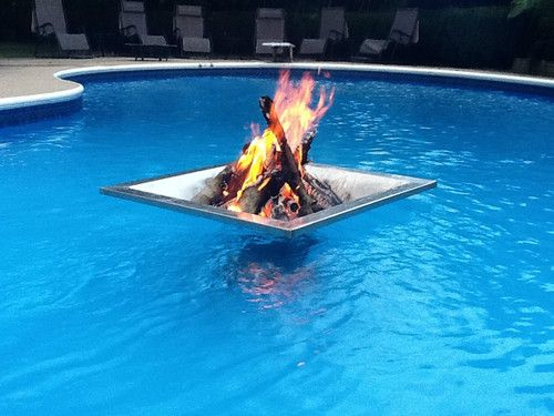 Floating Fire Pit...awsome idea....till you melt the fuck out of the liner  and your pool drains. BRILLIANT! - PYRE Floating Fire Pit For Swimming Pools, Ponds, Lakes, BBQ And