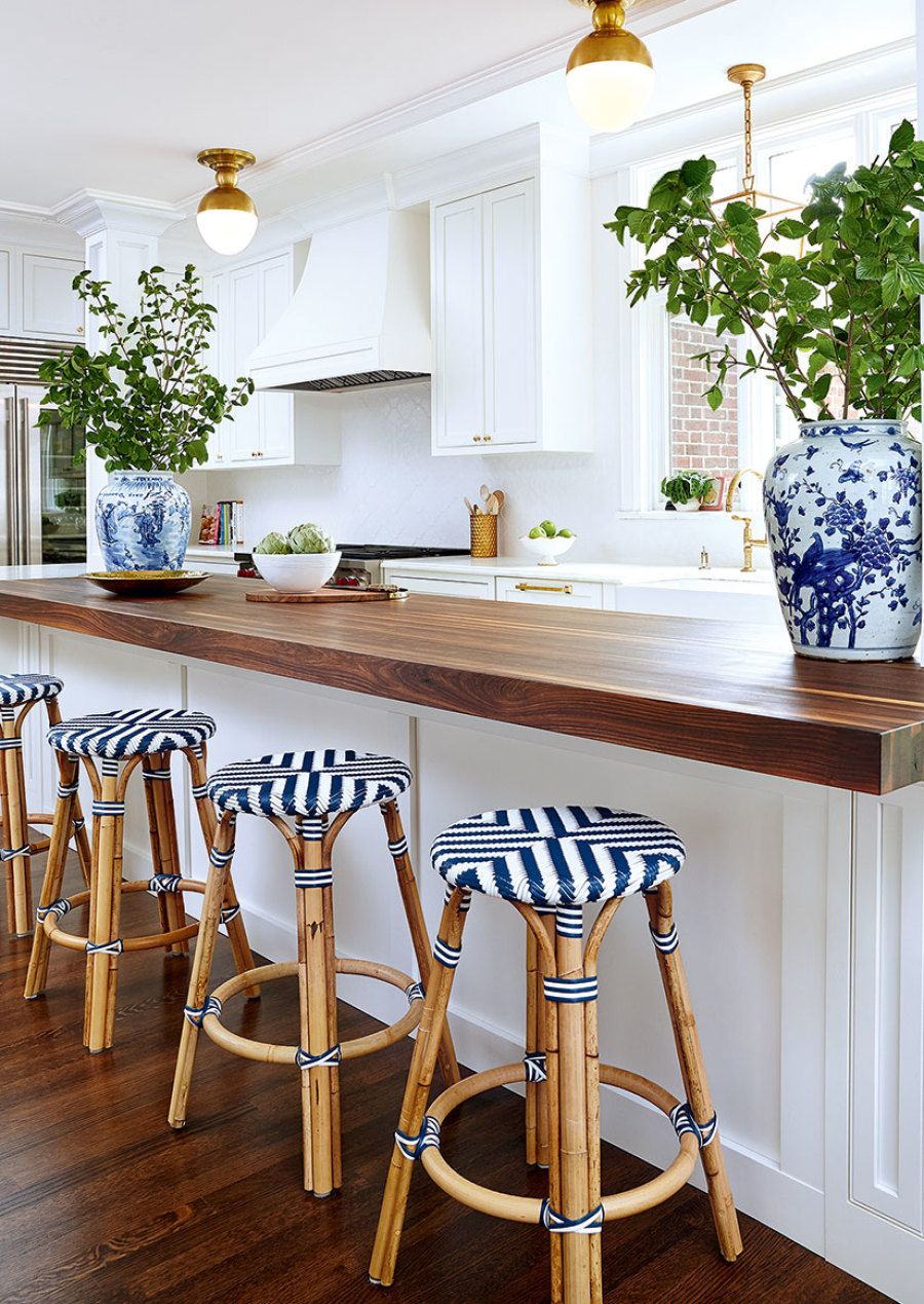 White Kitchen With Wood Counters And Navy Blue Accents Home