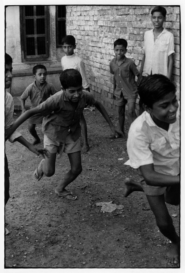 Boys playing in the street.. From Duke Digital Collections. Collection: William Gedney Photographs and Writings. Mark: None. Date of print: Unknown.