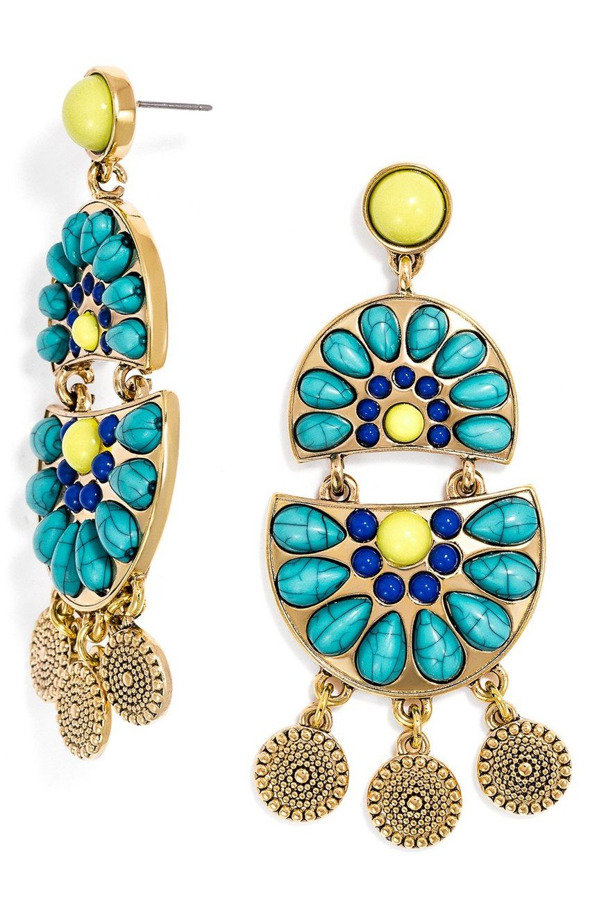 Turquoise-hued stones, colorful cabochons, and antiqued coin charms add a pop of style to these bold statement earrings from BaubleBar.