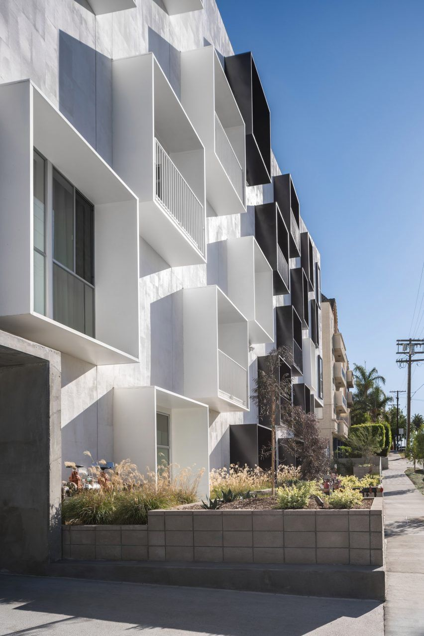 Called Mariposa1038, the building occupies a gently sloping site ...