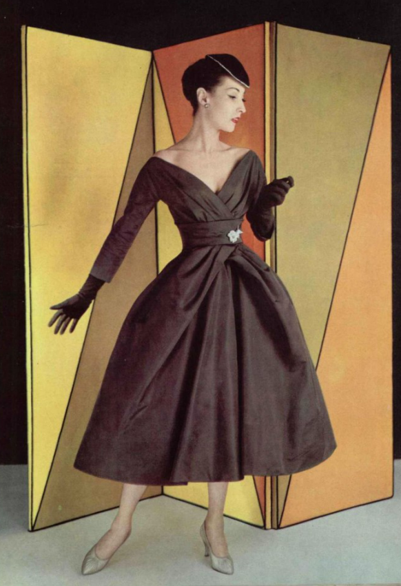 26c58762b1f Christian Dior 1957 fashion style couture 50s 60s black cocktail dress long  sleeves full skirt wide v off shoulder color photo print ad model magazine