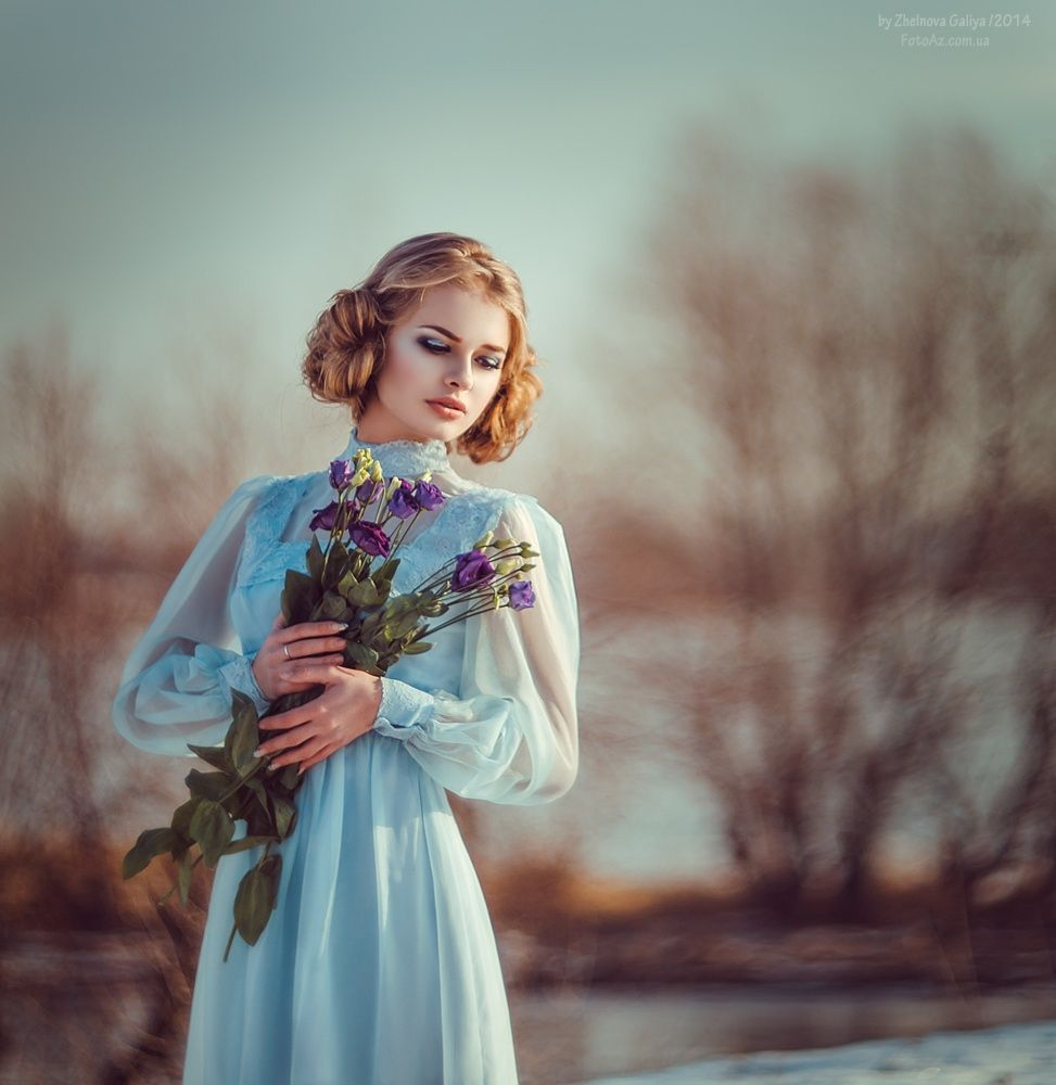 Photograph of beautiful Russian girl with a flower bouquet ...
