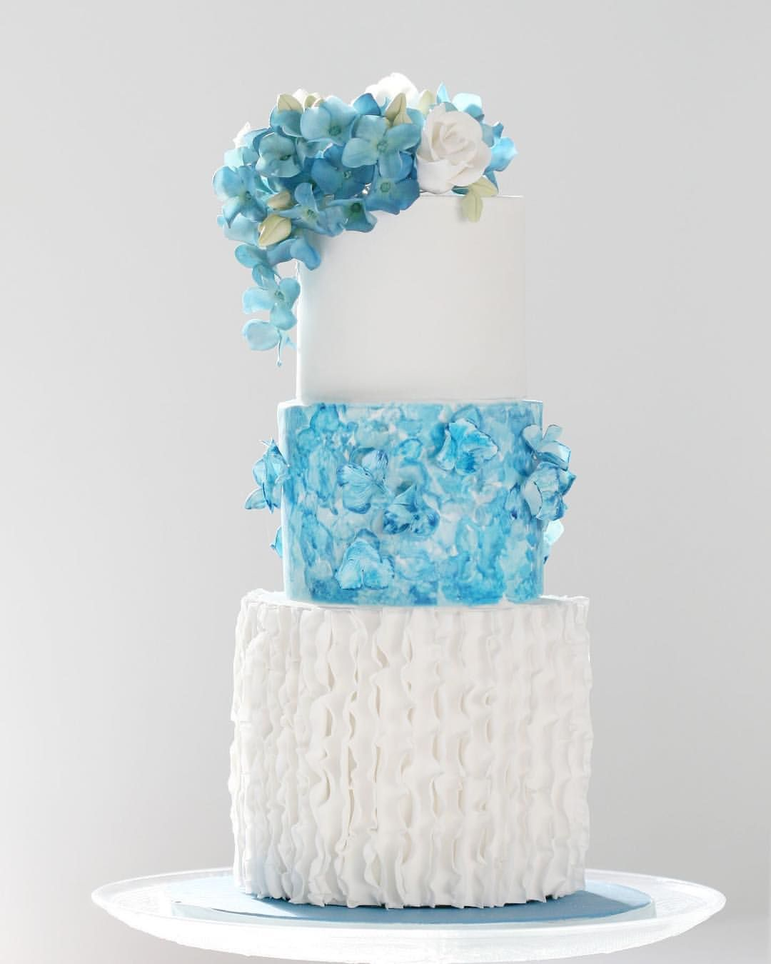 Wedding cake for a blue themed wedding with ruffles and sugar ...
