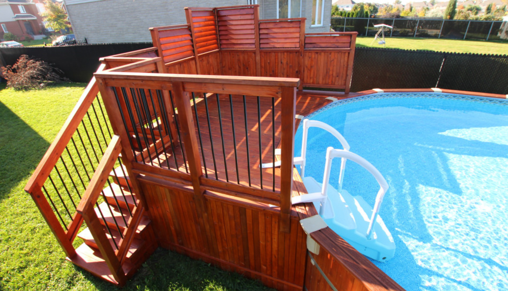 Beautiful Above Ground Pool Sectioned Louvered Privacy Fence Perfect For Minimal Privacy Neede Backyard Pool Landscaping Above Ground Pool Decks Backyard Pool