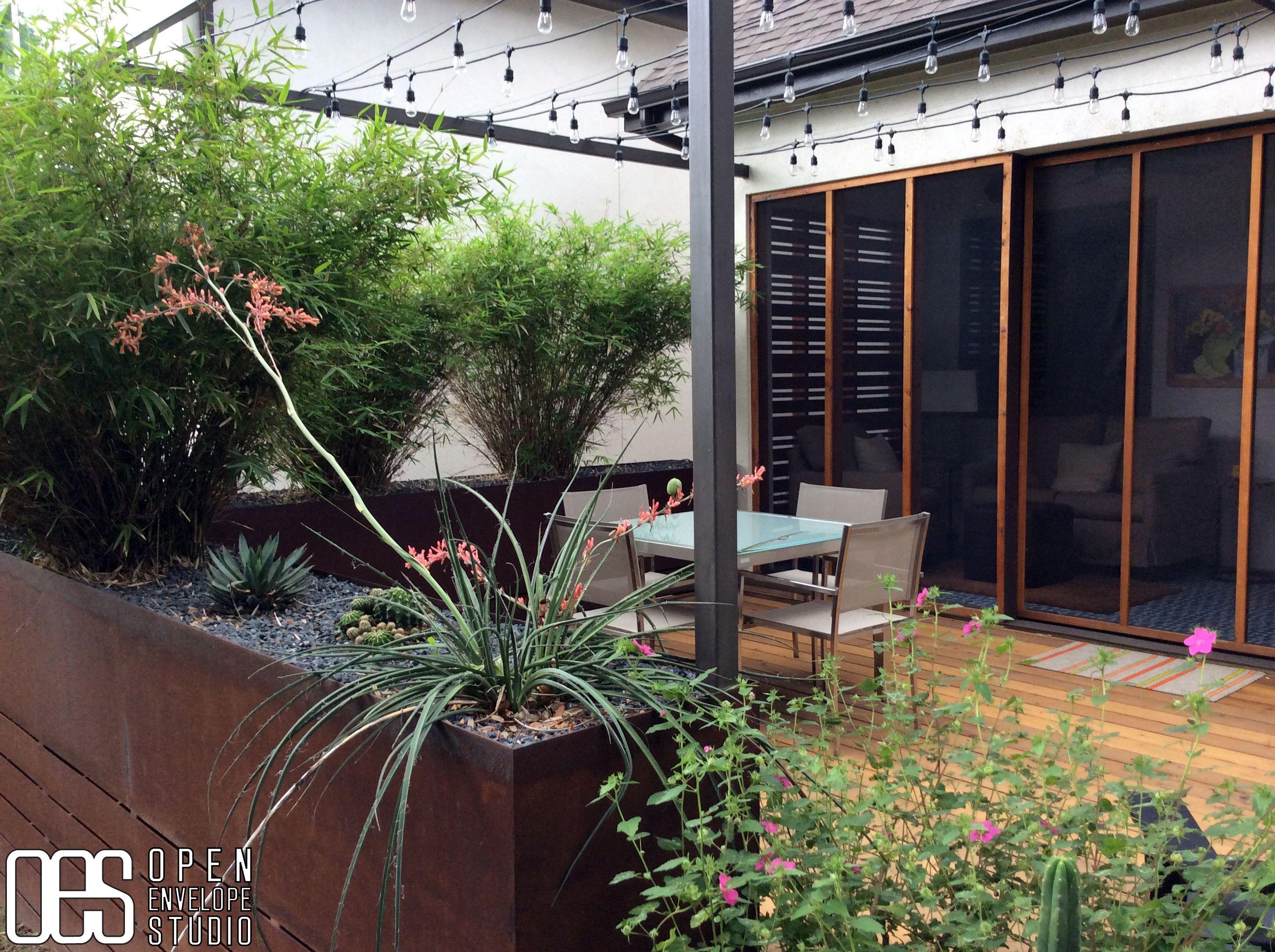 Open Envelope Studio|cedar deck with steel planters framed