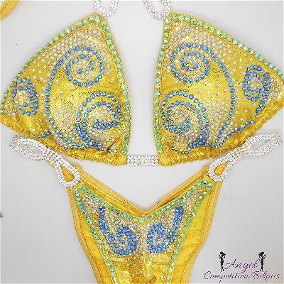 Swirl: sapphire ab and crystal ab. Hologram yellow. Peridot ab crystal – Angel Competition Bikinis