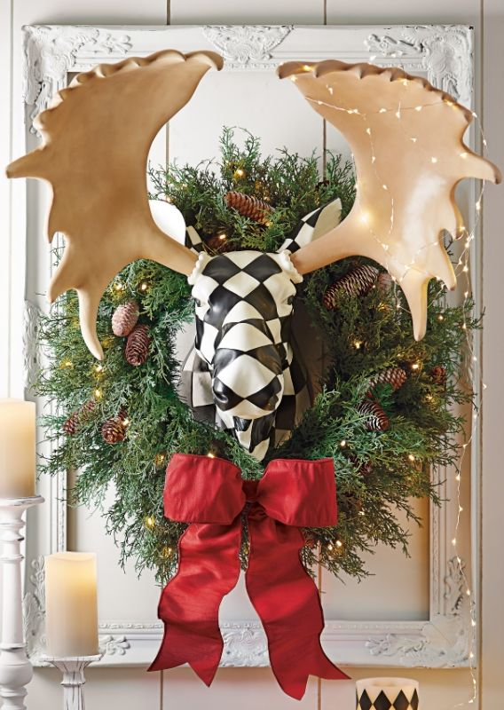 Put a fabulous new face on your holiday decorating with our life-size Harlequin Moose Head.