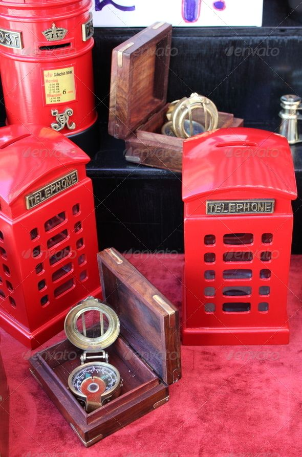 British souvenirs ...  box, britain, british, can, cash, charity, coin, compass, container, crown, currency, donate, donation, english, europe, finance, financial, giving, hand, help, kingdom, london, mailbox, metal, money, pay, payment, penny, phone, piggy, post, pound, quarter, red, relief, slot, souvenir, souvenirs, sterling, support, telephone, tin, trip, two, uk, united