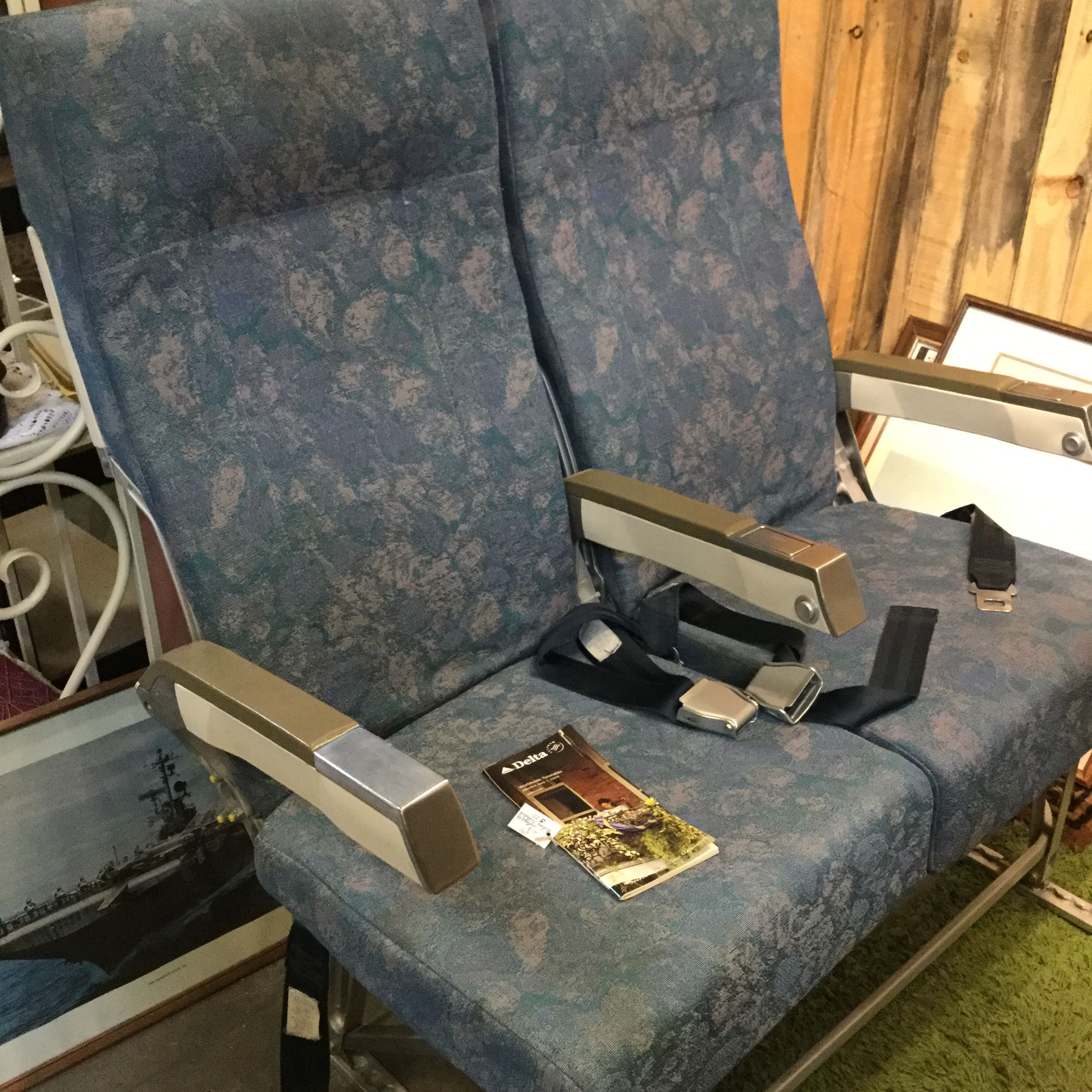 Vintage airline seats--with ash trays and fold down trays on the seat back. Who needs a recliner? $450 for the pair in Booth 28
