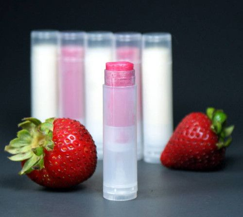 This homemade strawberry lip balm recipe is quick and easy to make, smells delectable and even adds a touch of pink to your lips! Made using natural ingredients like cocoa butter and coconut oil, this strawberry lip balm recipe also includes a touch of strawberry flavor oil and an optional pink colorant to give lips a sheer to bold color - you choose!