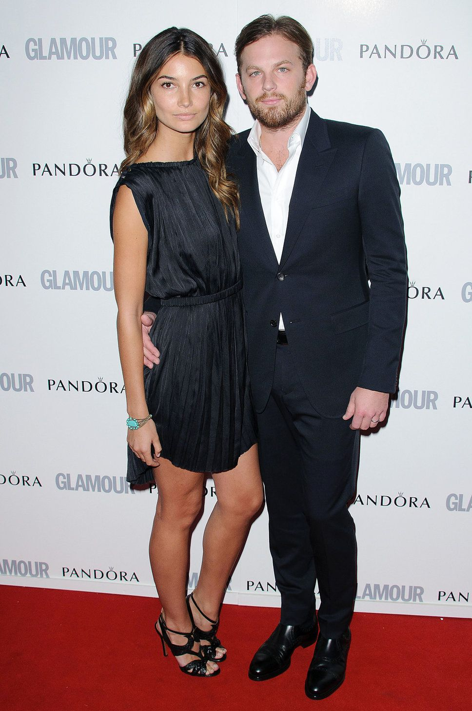 Lily Aldridge black dress brown curls pregnant and Caleb Followill ...
