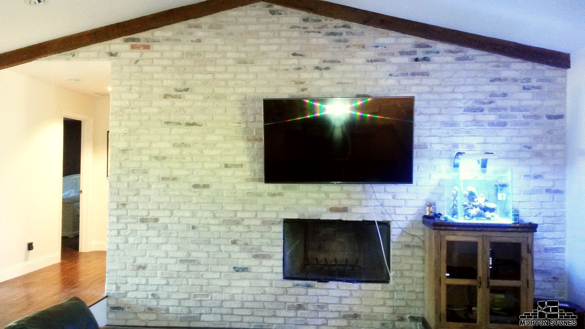 The perfect living room with a white brick fireplace mortonstones